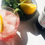Summer cocktails with lemon and mint and a bottle of flavor